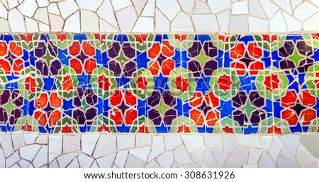 Mosaic wall at the Parc Guell designed by Antoni Gaudi located on Carmel Hill, Barcelona, Spain. - stock photo