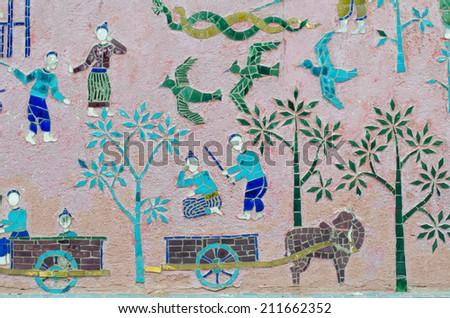 Mosaics at Red chapel at Wat Xieng Thong temple complex in Luang Prabang, Laos - stock photo