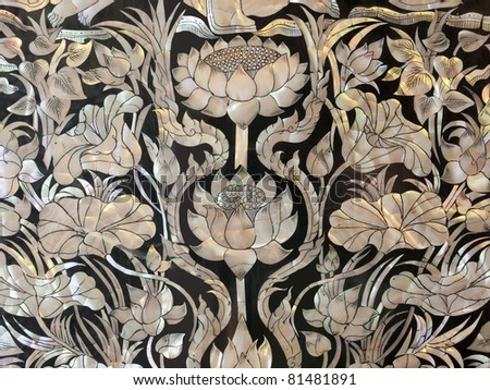 Mosaics lotus with a pearl shell in a Thai temple. - stock photo