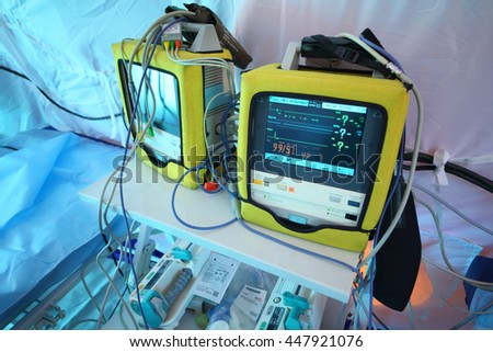 MOSCOW - APR 28, 2015: Bedside monitor with enabled screen in a modular tent of the field hospital - stock photo