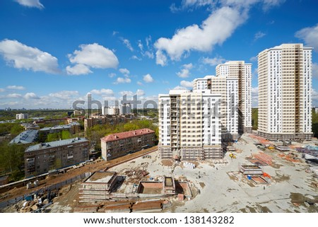 MOSCOW - APR 30: Buildings under construction of residential compound Elk Island, April 30, 2012, Moscow, Russia. This is 12-29 storey buildings with living area of 100 000 square meters. - stock photo