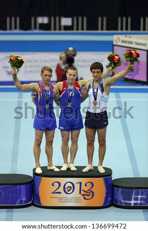 MOSCOW - APR 21: 2013 European Artistic Gymnastics Championships. Awarding of winners in Vault - Denis Ablyazin, Flavius Koczi and Artur Davtyan in Olympic Stadium on April 21, 2013 in Moscow, Russia - stock photo