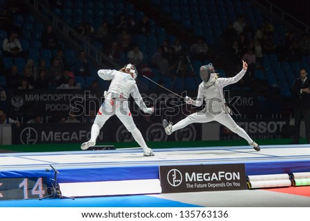 MOSCOW - APR 6: Midst of battle athletes on championship of world in fencing among juniors and cadets, in Sports Olympic complex, on April 6, 2012 in Moscow, Russia - stock photo