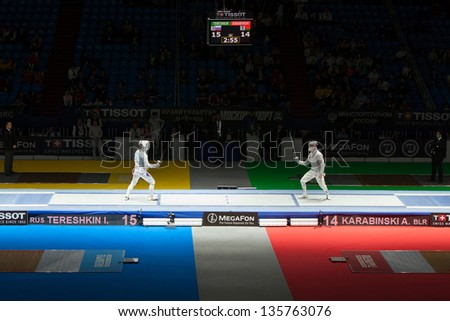 MOSCOW - APR 6: Tereshkin and Karabinski compete  on championship of world in fencing among juniors and cadets, in Sports Olympic complex, on April 6, 2012 in Moscow, Russia - stock photo