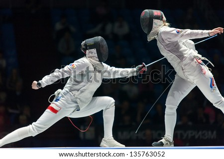 MOSCOW - APR 6: Women compete on championship of world in fencing among juniors and cadets, in Sports Olympic complex, on April 6, 2012 in Moscow, Russia - stock photo