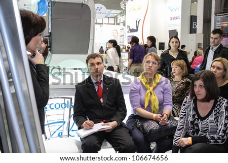 MOSCOW-APRIL 19: Beautician giving a presentation at the international exhibition of professional cosmetics and beauty salon equipment INTERCHARM on April 19, 2012 in Moscow - stock photo