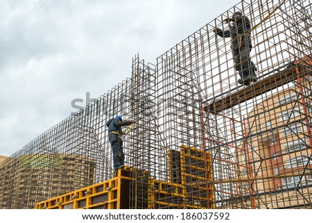 MOSCOW - APRIL 3: Construction site workers on april 3, 2014 in Moscow, Russia. Urban construction is at a faster pace in Russia. - stock photo