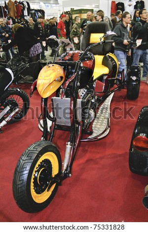 MOSCOW - APRIL 1: Custom yellow tricycle at the Moscow specialized Exhibition  of motor cycling industry in Russia on April 1, 2011 in Moscow, Russia