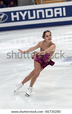 """MOSCOW - APRIL 30: Elena Glebova competes in single ladies free figure skating at the 2011 World Championship on April 30, 2011 at the Palace of sports """"Megasports"""" in Moscow, Russia. - stock photo"""