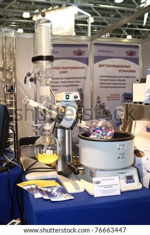 MOSCOW - APRIL 28: EYELA rotary evaporator with integrated heating bath at the international exhibition of analytical and laboratory equipment in Russia and CIS on April 28, 2011 in Moscow, Russia.