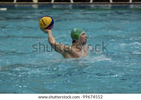 MOSCOW - APRIL  6: Halturin P. of Sintez atack Dynamo`s gate during a game Dynamo(white) vs Sintez (green) of waterpolo Championship of Russia on April 6, 2012 Moscow, Russia. Sintez won 13:10 - stock photo