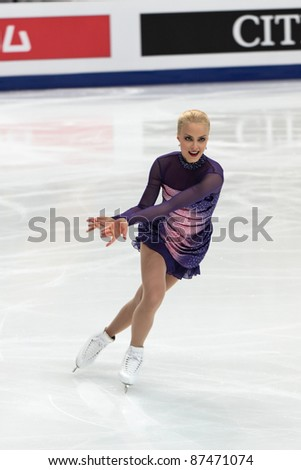 """MOSCOW - APRIL 30: Kiira Korpi competes in the single ladies free figure skating event at the 2011 World championship on April 30, 2011 at the Palace of sports """"Megasport"""" in Moscow, Russia. - stock photo"""