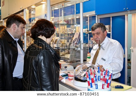 MOSCOW - APRIL 27: Man sells dental tools at the international exhibition of the dental professionals and industry on April 27, 2011 in Moscow - stock photo