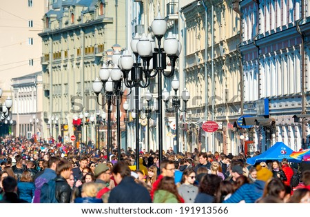 MOSCOW - April 13: Many people walking on the famous Arbat street on April 13, 2014 in Moscow. This street is one of the few pedestrian streets in Moscow, which is usually visited by tourists. - stock photo