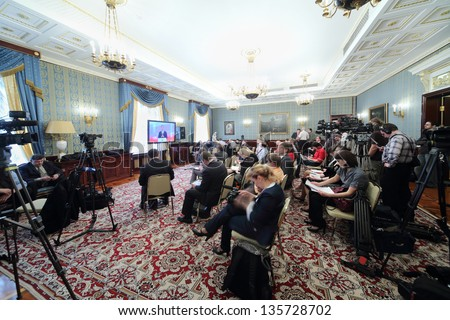 MOSCOW - APRIL 24: Newspapermen and cameramen work on Enlarged meeting of Council in Grand Kremlin Palace on April 24, 2012 in Moscow, Russia. - stock photo