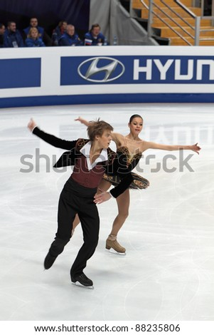 "MOSCOW - APRIL 30: Nikita Katsalapov and Elena Ilinykh compete in the pair ice dance at the 2011 World championship figure skating event at the Palace of sports ""Megasport"" on April 30, 2011 in Moscow, Russia. - stock photo"