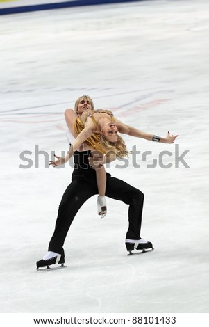 "MOSCOW - APRIL 30: Pernelle Carron and Lloyd Jones compete in the pair ice dance at the 2011 World championship figure skating event at the Palace of sports ""Megasport"" on April 30, 2011 in Moscow, Russia."