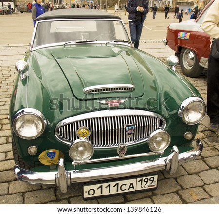 MOSCOW - APRIL 21: retro car Austin Healey on rally of classical cars on Poklonnaya hill,  April 21, 2013, in town Moscow, Russia, unidentified people looking at rally.