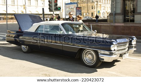 MOSCOW - APRIL 27, 2014: retro car cadillac on rally of classical cars, organized by Russian Club of Classical Autocars on Theatre square.  - stock photo