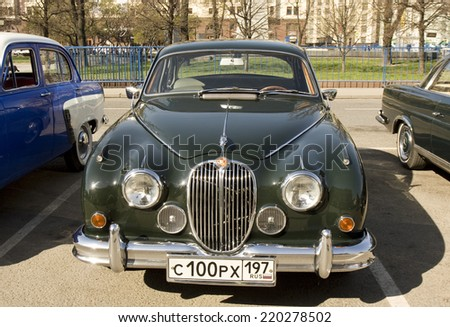 MOSCOW - APRIL 27, 2014: retro car jaguar of 1967 year on rally of classical cars, organized by Russian Club of Classical Autocars on Theatre square.  - stock photo