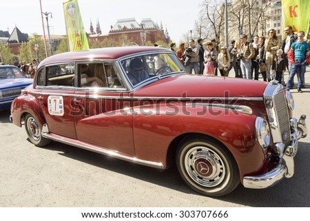 MOSCOW - APRIL 27, 2014: retro car mercedes on rally of classical cars, organized by Russian Club of Classical Autocars on Theatre square.  - stock photo