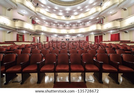 MOSCOW - APRIL 23: Seats in auditorium in Vakhtangov Theatre on April 23, 2012 in Moscow, Russia. Vakhtangov Theater is located in historical center of Moscow, on Old Arbat. - stock photo