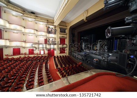 MOSCOW - APRIL 23: Side view of auditorium and stage in Vakhtangov Theatre on April 23, 2012 in Moscow, Russia. Light and sound systems of Vakhtangov Theatre are one of best in Russia.