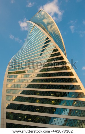 MOSCOW- APRIL 25, 2016:Steel and glass corporate buildings reflect the sky and clouds, Moscow - stock photo