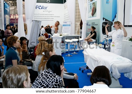 MOSCOW - APRIL 15: Unidentified beauticians giving a presentation at the international exhibition of professional cosmetics and beauty salon equipment INTERCHARM on April 15, 2011 in Moscow - stock photo