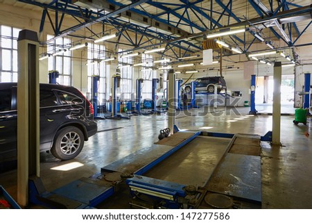 MOSCOW - AUG 22: Cars and lift platform at workshop of Service station Avtostandart, August 22, 2012, Moscow, Russia. Avtostandart specializes in repair and servicing of Korean and Japanese cars.