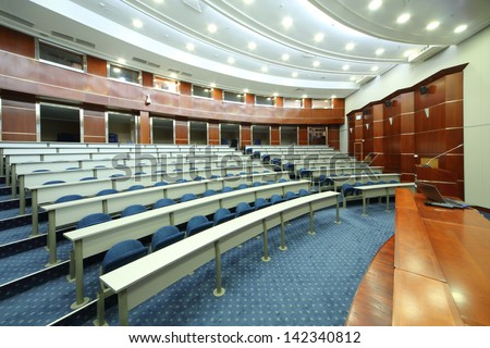 MOSCOW - AUG 18: Desks and seats in empty university auditorium in MGIMO, on Aug 18, 2012 in Moscow, Russia. Among MGIMO graduates more than five thousand foreign citizens from more than 60 countries. - stock photo