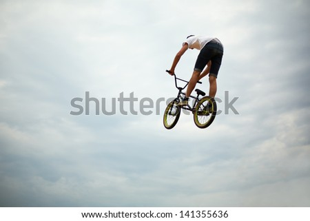 MOSCOW - AUG 4: Guy jumps on bike at All-Russian Exhibition Centre during holiday dedicated to 73d birthday of country main exhibition, August 4, 2012, Moscow, Russia.