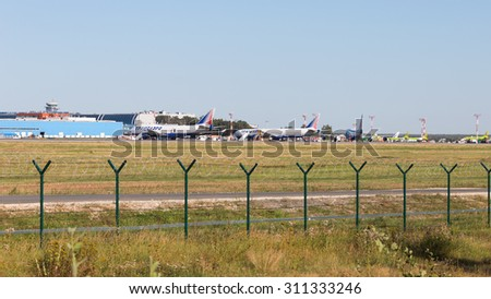 Moscow - August 6, 2015: Cargo terminal, control tower and planes at Domodedovo airport and runway August 6, 2015, Moscow, Russia