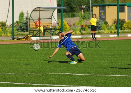 MOSCOW - AUGUST 18: Pushkareva M. (16) fall down on game Kubanochka vs CSP Izmailovo on Russian tournament of wemen football league on August 18, 2013, in Moscow, Russia