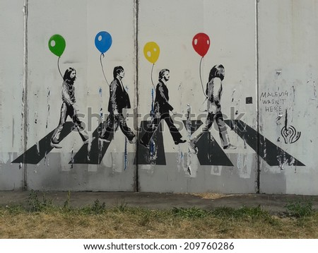 MOSCOW - AUGUST 3: The Beatles Abbey Road graffiti on the white wall in Moscow, August 3, 2014. Lusinovskaya street. - stock photo