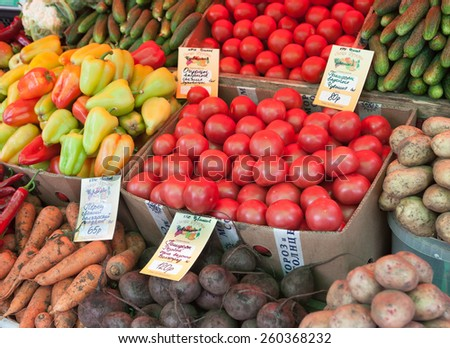 MOSCOW - AUGUST 08: Tomatoes, peppers, cucumbers, beets, potatoes at Vegetable Fair counter on Leskov Street on August 8, 2014 in Moscow. - stock photo