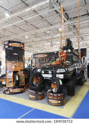 MOSCOW-AUGUST 26: Unknown model demonstrates tires MAXXIS Taiwanese company at the International Exhibition Automechnika on August 26, 2013 in Moscow