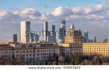 Moscow city and modern Moscow architecture beyond the chemistry faculty of Moscow State University built in Stalin epoch  - stock photo