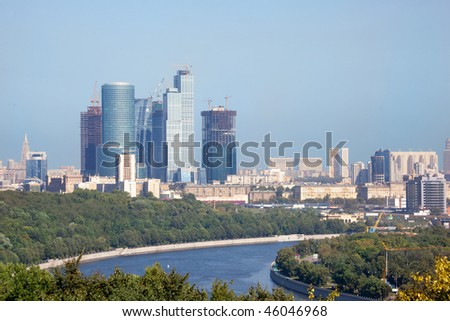 Moscow city urban view. construction of high building scraper skyscraper. building of business center. Buildings from glass and concrete. Moscow river on near plan - stock photo