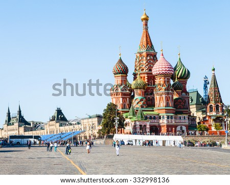 Moscow cityscape - Pokrovsky Cathedral and Vasilevsky Descent of Red Square of Moscow Kremlin in summer afternoon - stock photo