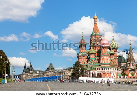 Moscow cityscape - Saint Basil Cathedral and Vasilevsky Descent of Red Square of Moscow Kremlin in sunny summer day - stock photo