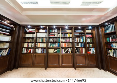 MOSCOW - DEC 6:  Library with bookcase at the Baltschug Kempinski Moscow Hotel on December 6, 2012 in Moscow, Russia. - stock photo