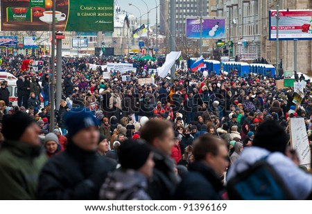 MOSCOW - DEC 24: Mass protest against parliamentary elections in Russia at Sakharov avenue. Biggest protest in Russia for the last 20 years, December 24, 2011 in Moscow, Russia. - stock photo