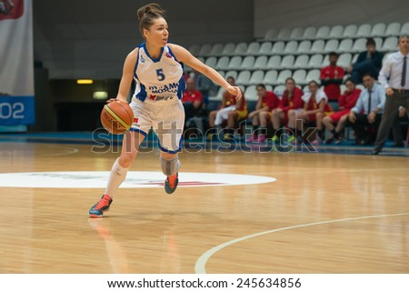 MOSCOW - DECEMBER 4, 2014: A Ostroukhova (5) on the International Europe bascketball league match Dynamo Moscow vs Maccabi Ashdod Israel in sport palace Krilatskoe, Moscow, Russia. Dynamo loss 59:67 - stock photo
