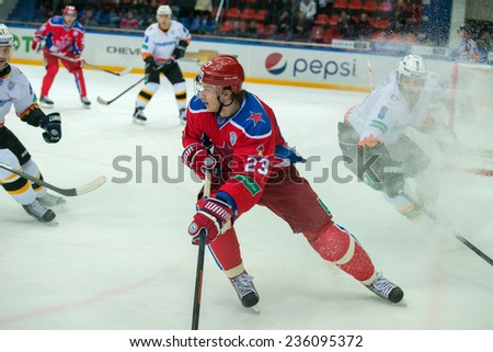 MOSCOW - DECEMBER 3: Andrei Stas (23) on the game CSKA vs Severstal on Russian KHL premier hockey league Championship on December 3, 2014, in Moscow, Russia. CSKA won 9: 1 - stock photo