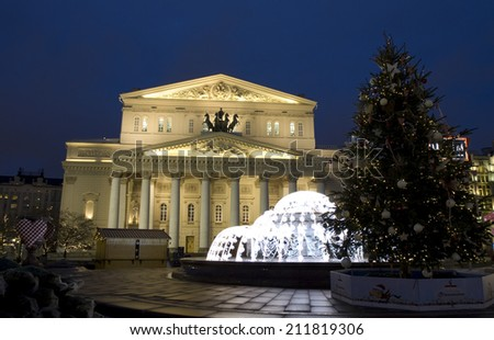 MOSCOW - DECEMBER 24, 2013: Big (Bolshoy) theatre, electric fountain and Christmas tree.