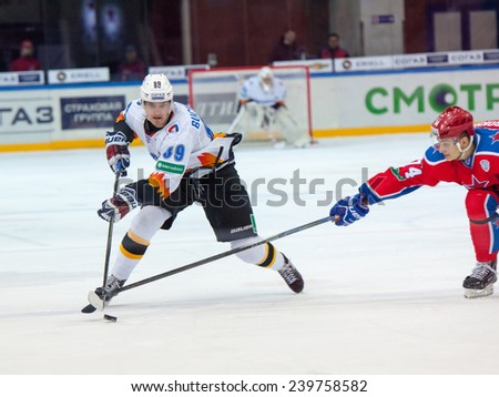 MOSCOW - DECEMBER 3: Buchnevich Pavel (89) fights on game CSKA vs Severstal on Russian KHL premier hockey league Championship on December 3, 2014, in Moscow, Russia. CSKA won 9:1 - stock photo