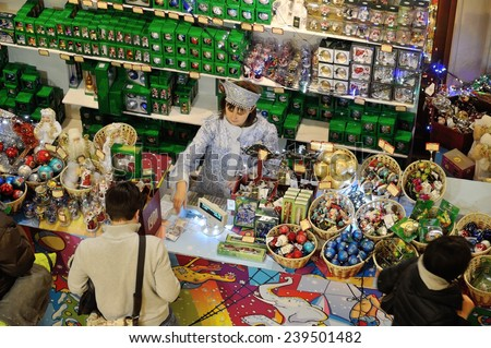 MOSCOW - DECEMBER 21: Buyers and seller in Christmas toys department at the GUM store on December 21, 2014 in Moscow. - stock photo