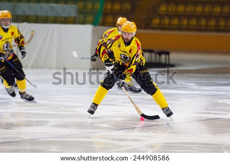 MOSCOW - DECEMBER 12, 2014: Chighov Alexey (8) in action during the Russian  bandy league game Dynamo Moscow vs SKA Neftyanik in sport palace Krilatskoe, Moscow, Russia. Dynamo won 9:1 - stock photo