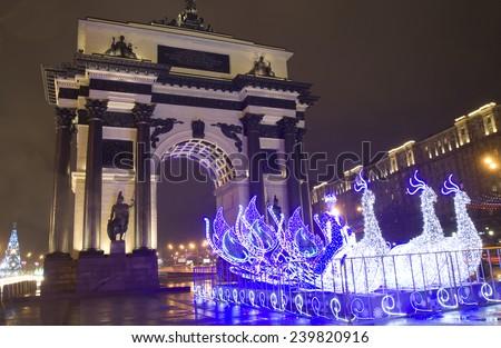 MOSCOW - DECEMBER 23, 2014: Christmas illumination in memorial complex on Poklonnaya hill near Triumphal arch. - stock photo
